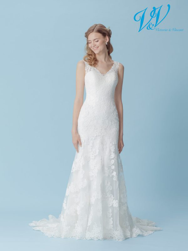 A romantic fit and flair wedding dress with an open back. Very high quality lace.