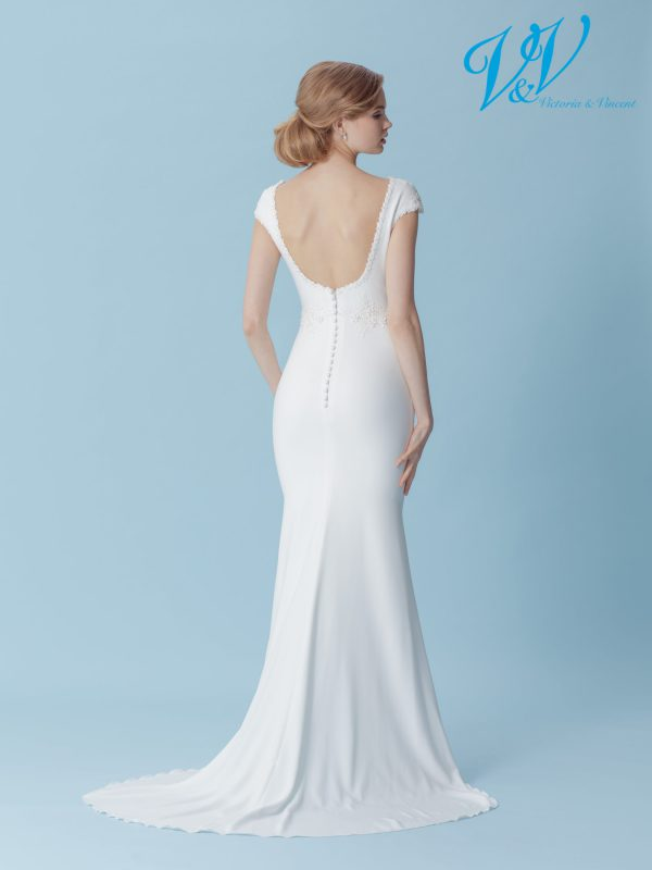 A classic backless wedding dress.