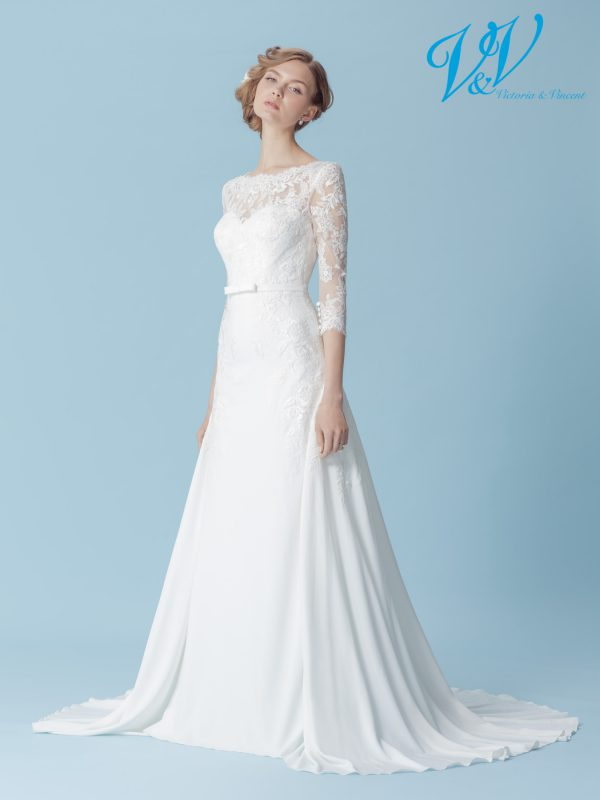 A boho bridal dress with long sleeves and gorgeous lace details. Very high quality crepe.