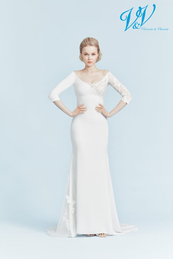 A simple wedding dress with sleeves and an open back.