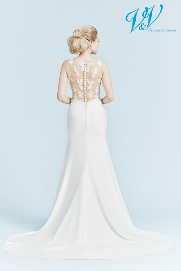 A sexy wedding dress with an illusion lace back. Very high quality crepe.