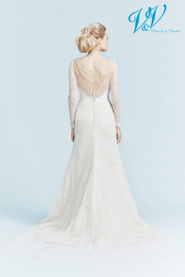 A backless wedding dress with long sleeves.