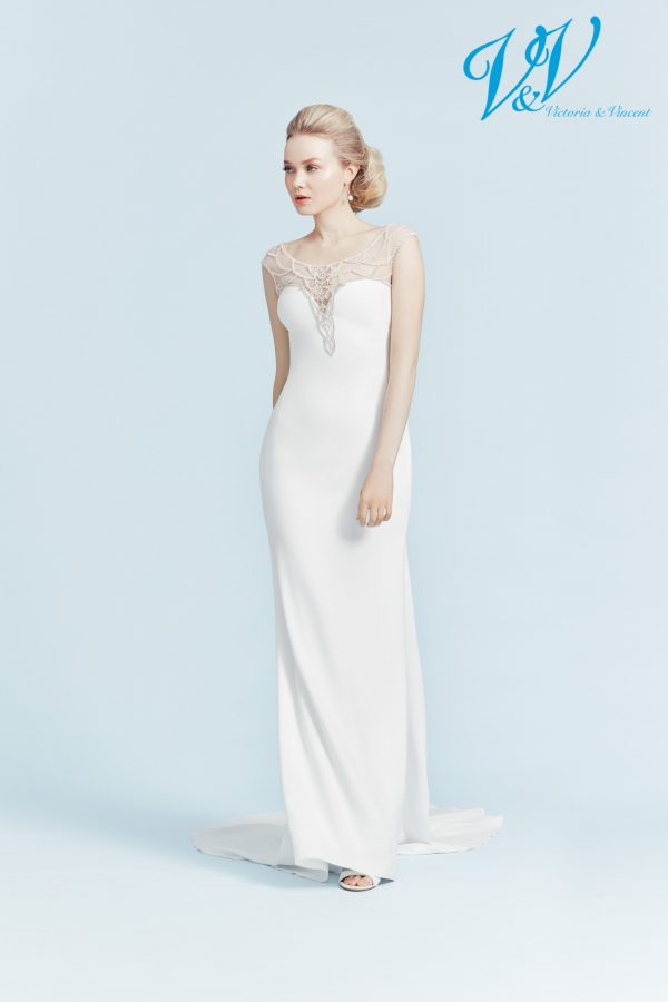 A romantic wedding dress with an illusion lace back.