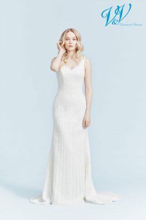 A simple vintage wedding dress. Perfect for a beach wedding.