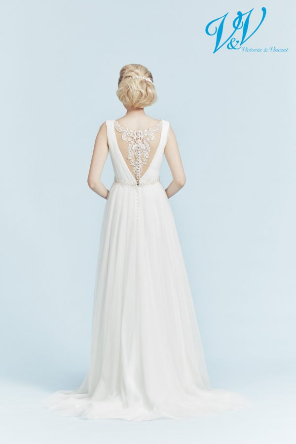 An A-Line wedding dress with a beautiful illusion back.