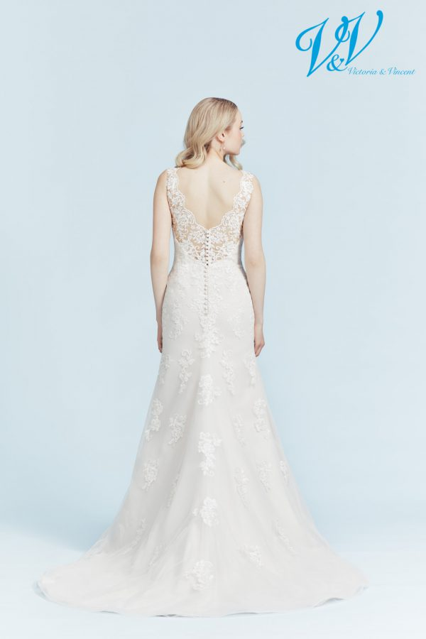 A classic fit and flair wedding dress. Very high quality lace.
