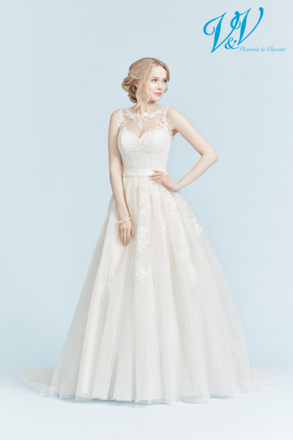 An A-Line wedding dress with a keyhole back that makes you feel like a princess.