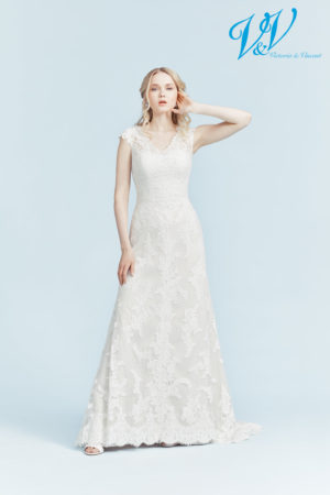 A strapless lace wedding gown with an open back.