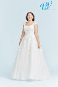 A plus size lace wedding dress. Lace-up back for a classic princess feeling.