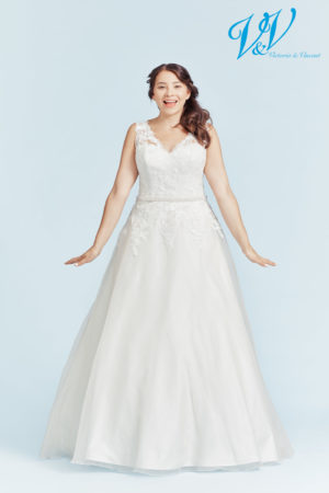 A plus size wedding dress with shoulder straps. Very high quality organza.