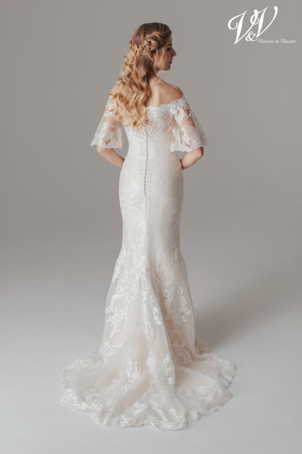 An off shoulder wedding dress with a beautiful illusion lace back. Perfect for a vintage look.