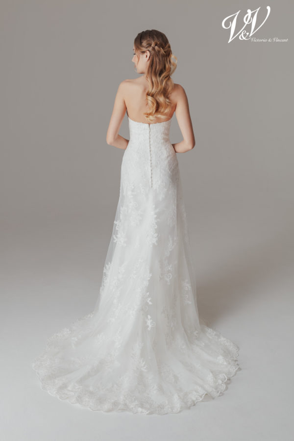 A backless A-Line wedding dress for a simple elegant look.