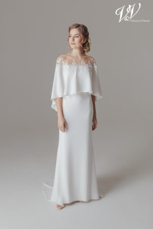 A simple sheath bridal dress with sleeves.