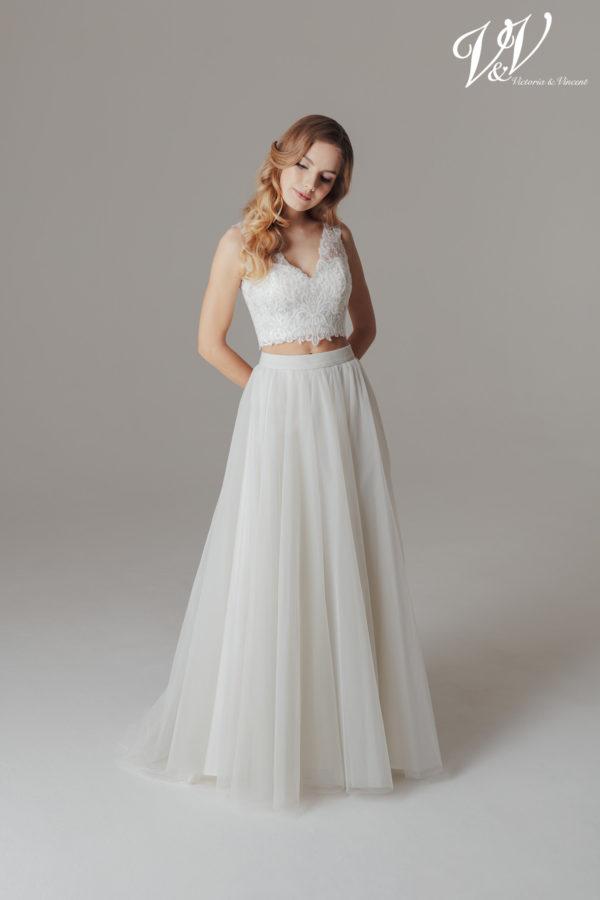 A sexy two-piece wedding dress with a modern boho flair. Perfect for a beach wedding.