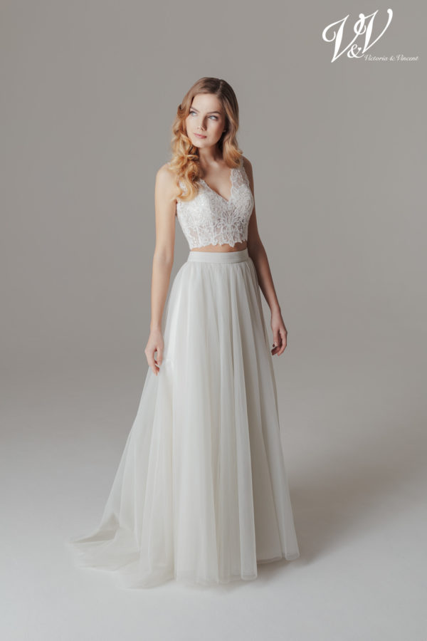A sexy two-piece wedding dress with a modern boho flair. Perfect for a beach wedding.
