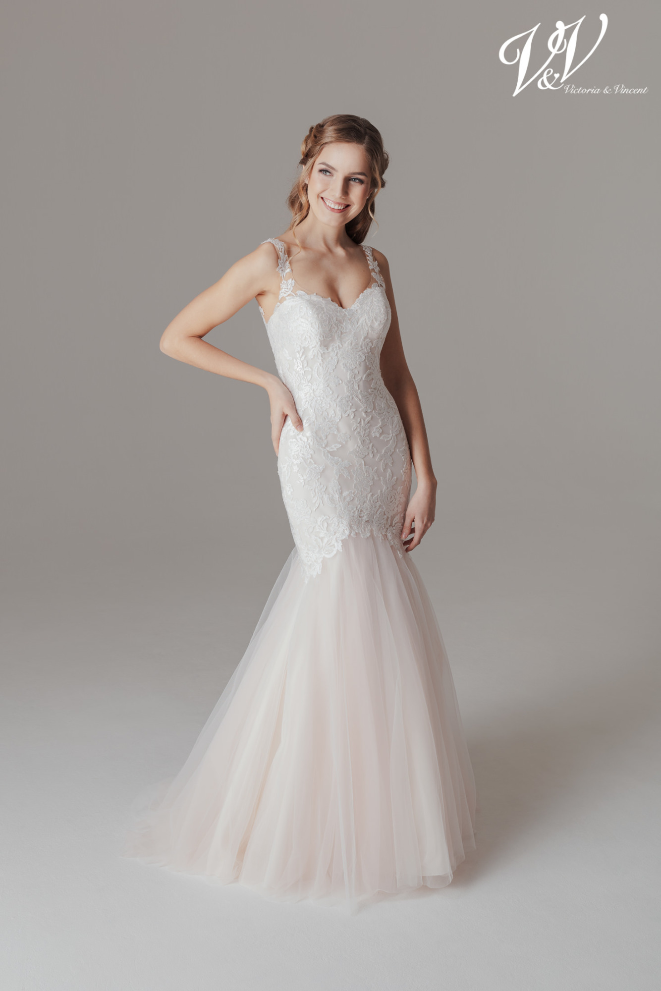 A mermaid wedding dress with a sweetheart neckline and an open back.
