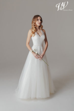 A backless A-Line wedding dress with a halter neck. Very high quality tulle.