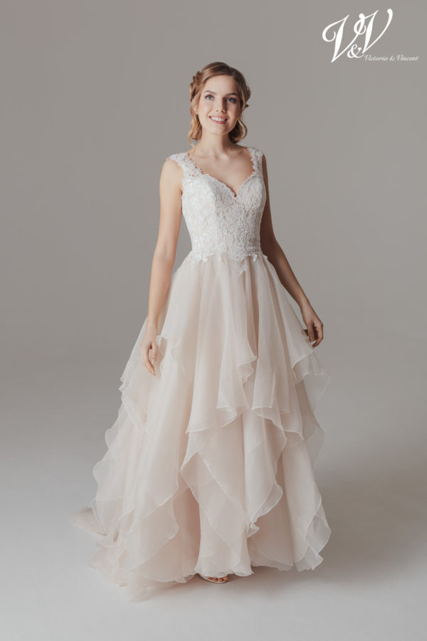 A princess wedding dress with a sweetheart neckline and a beautiful illusion lace back. Very high quality tulle.