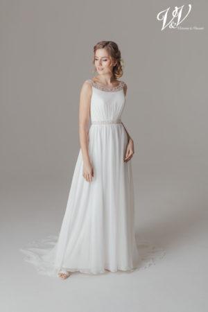 A classic sheath style chiffon wedding dress.