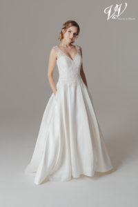 A vintage wedding dress with shoulder straps and pockets! Very high quality mikado.