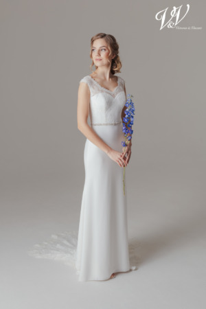 A gorgeous boho bridal dress with an illusion lace back. Perfect for a summer wedding.