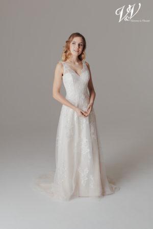 An A-Line wedding dress with an open back. Perfect for a beach wedding.