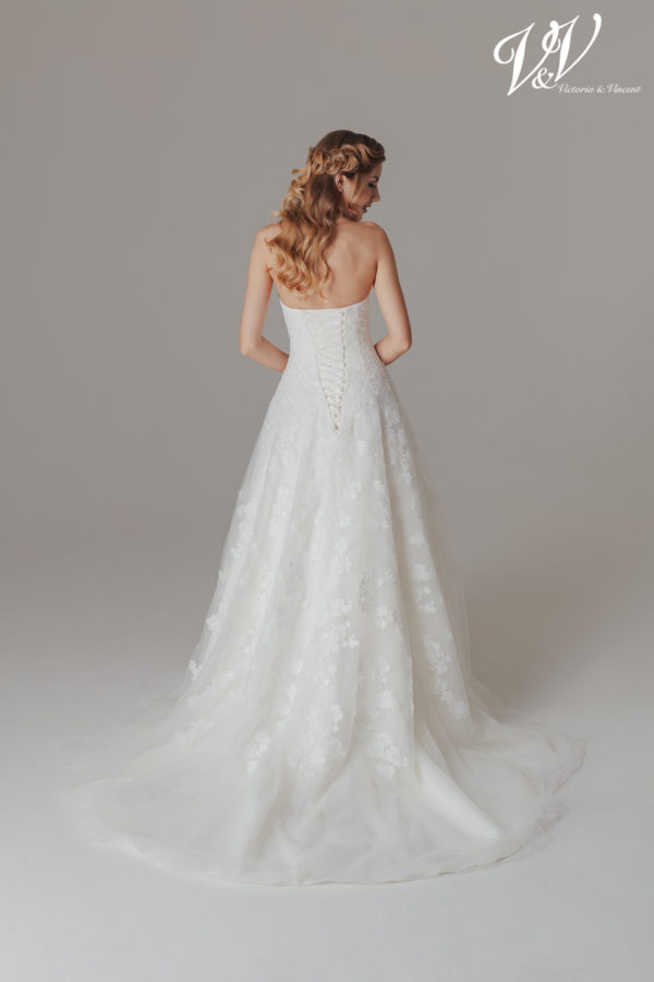 A sexy princess wedding dress with a lace-up back. Very high quality lace.