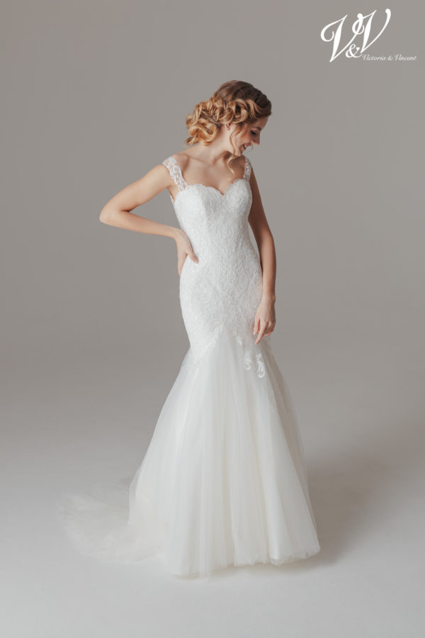 An off shoulder mermaid wedding dress with an elegant feel to it.