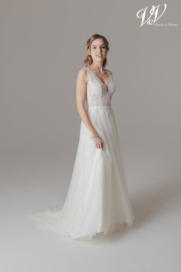 A sexy lace wedding dress with an open back. Perfect for a vintage look.