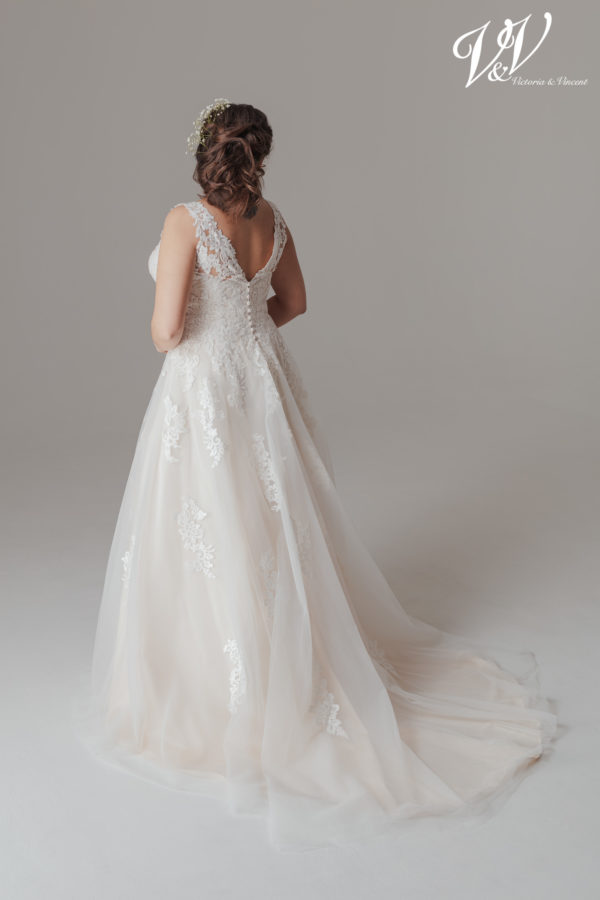 A romantic plus size wedding dress. Very high quality lace. Perfect for a classic church wedding.