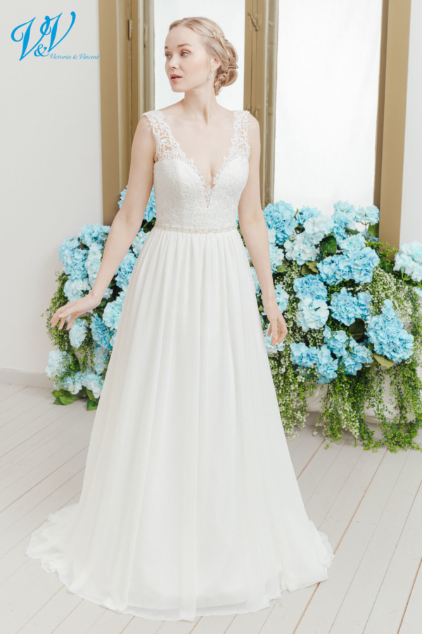 Backless A-Line wedding dress with straps. An elegant lace top with high-quality chiffon skirt. Color in the picture is ivory / nude but this bridal gown is also available in all ivory and white.