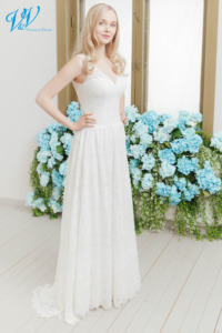 Romantic vintage wedding dress with shoulder straps. Made of very high quality chiffon and lace. Color in the picture is ivory but this bridal gown is also available in white.