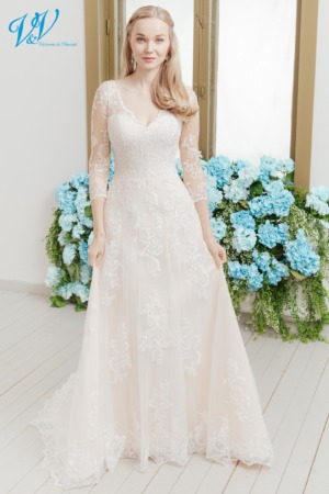 Beautiful wedding dress with lace sleeves and a sweetheart neckline. The most affordable premium quality traditional wedding dress on the market. Color in the picture is lt champagne but this bridal gown is also available in all ivory and white.