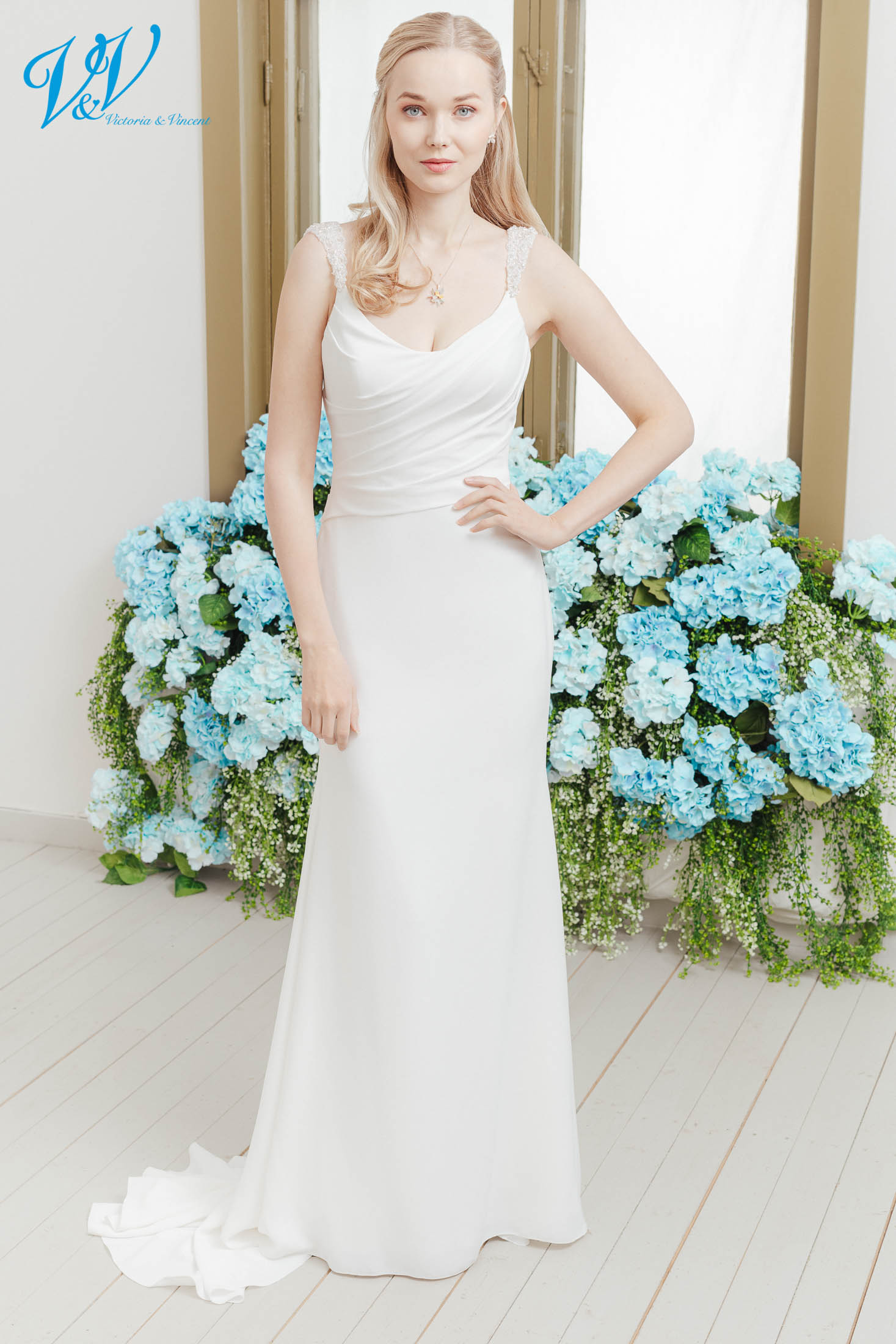 The most affordable premium quality mermaid wedding dress on the market. Made from high-quality crepe with sparkly shoulder straps. Color in the picture is ivory but this bridal gown is also available in white.