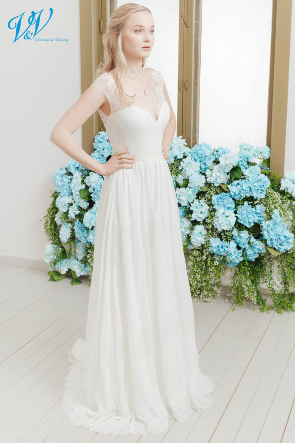 Sleeveless wedding gown made from chiffon with boho lace details. The most affordable premium quality vintage wedding dress on the market. Color in the picture is ivory / nude but this bridal gown is also available in all ivory and white.