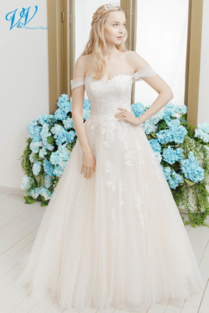 This romantic bridal gown has removable off shoulder straps. Made from high quality tulle and lace. The most affordable premium quality princess wedding dress on the market. Color in the picture is ivory / salmon / mistyrose but this bridal gown is also available in all ivory and white.