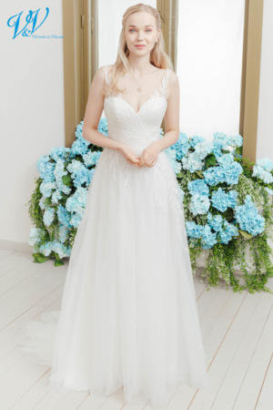 Beautiful princess wedding dress with stunning lace patterns. Made of very high quality tulle. Color in the picture is ivory / nude / lt grey but this bridal gown is also available in all ivory and white.