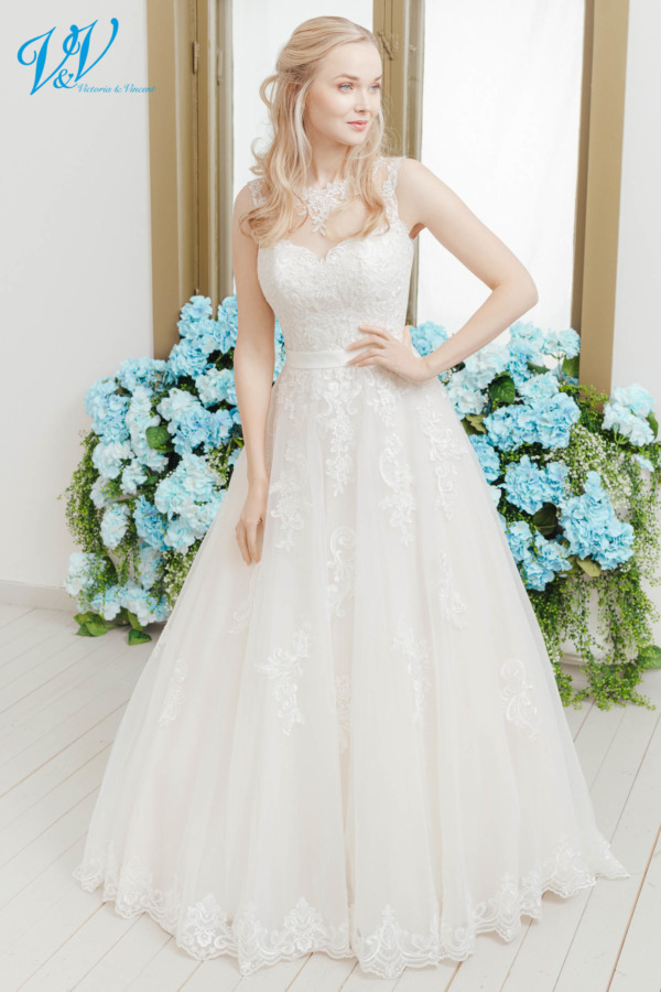 Classic bridal dress with a romantic flair. The most affordable premium quality lace wedding dress on the market. Color in the picture is ivory / nude / lt champagne but this bridal gown is also available in all ivory and white.