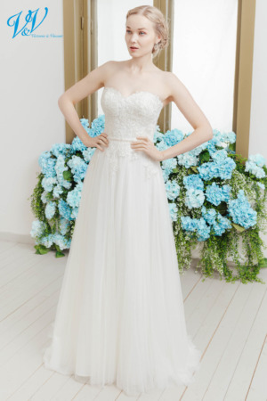 Sheath bridal gown perfect for a summer wedding. The most affordable premium quality strapless wedding dress on the market. Color in the picture is ivory but this bridal gown is also available in white.