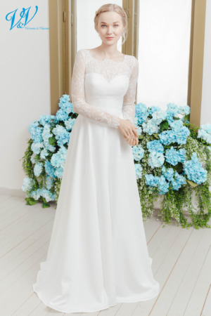 Amazing wedding dress with long sleeves. Made from high-quality crepe in a traditional style. Color in the picture is ivory but this bridal gown is also available in white.