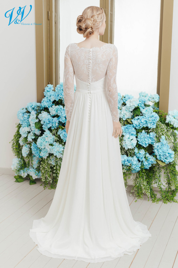 Chiffon wedding dress with long sleeves, a closed back and a high quality chiffon skirt. This traditional bridal gown makes you look fantastic. Color in the picture is ivory but this bridal gown is also available in white.