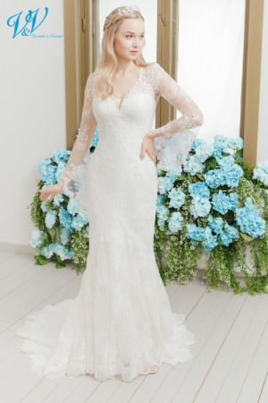 Mermaid wedding dress with gorgeous back. Romantic and elegant made from high-quality lace. Color in the picture is ivory / nude / salmon but this bridal gown is also available in all ivory and white.