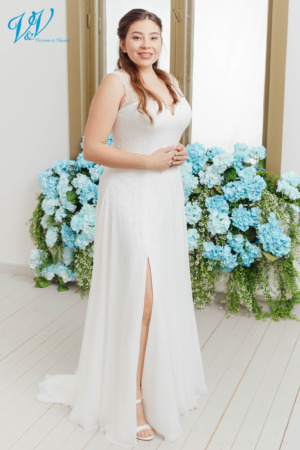 Elegant plus size wedding gown with a closed back. Made from high quality chiffon. Built-in corset belt for additional support. Color in the picture is ivory / nude but this bridal gown is also available in all ivory and white.