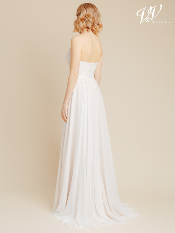 This backless wedding dress is made of very high quality chiffon. The top is decorated with beautiful lace patterns. Affordable, but very well supported and well crafted bridal gown. Color in the picture is ivory / cappuccino but this bridal gown is also available in all ivory