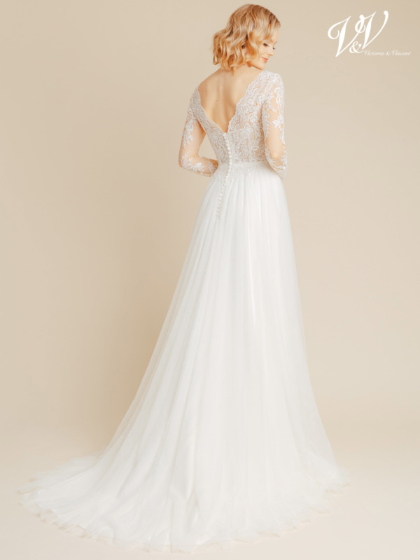 Beautiful A-line wedding dress with long sleeves. The top and sleeves are decorated with lace patterns. The skirt is made of very high quality tulle. The most affordable premium quality wedding dress with sleeves on the market. Color in the picture is ivory / nude but this bridal gown is also available in all ivory.