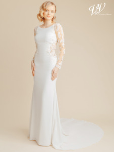 An elegant modern wedding dress with long sleeves. Made of very high quality crepe. The illusion back is decorated with beautiful lace patterns. The most affordable premium quality crepe wedding dress on the market. Color in the picture is ivory / nude but this bridal gown is also available in all ivory.